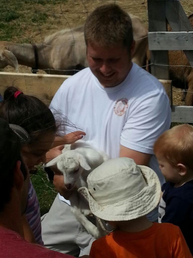 Ryan showing off baby Abby at last summer's open house!